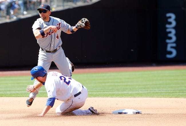 Aug 25, 2013; New York, NY, USA;  Detroit Tigers second baseman Omar Infante (4) turns a double play over New York Mets first baseman Ike Davis (29) during the fourth inning at Citi Field. Mandatory Credit: Anthony Gruppuso-USA TODAY Sports