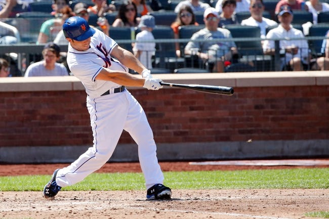 Aug 25, 2013; New York, NY, USA; New York Mets catcher Travis d'Arnaud (15) hits a two-run home run during the fourth inning against the Detroit Tigers at Citi Field. Mandatory Credit: Anthony Gruppuso-USA TODAY Sports