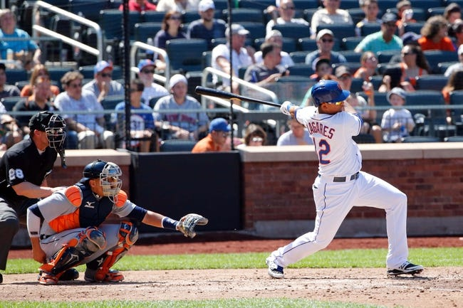 Aug 25, 2013; New York, NY, USA;  New York Mets center fielder Juan Lagares (12) reaches on an infield single to the shortstop during the fourth inning against the Detroit Tigers at Citi Field. Mandatory Credit: Anthony Gruppuso-USA TODAY Sports
