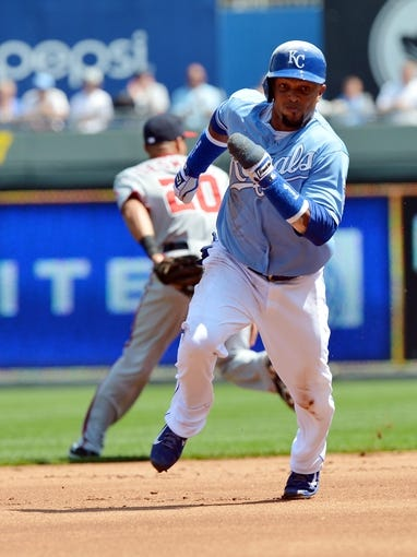 Aug 25, 2013; Kansas City, MO, USA; Kansas City Royals second basemen Emilio Bonifacio (64) scores as he rounds second base against the Washington Nationals during the first inning at Kauffman Stadium.  Mandatory Credit: Peter G. Aiken-USA TODAY Sports