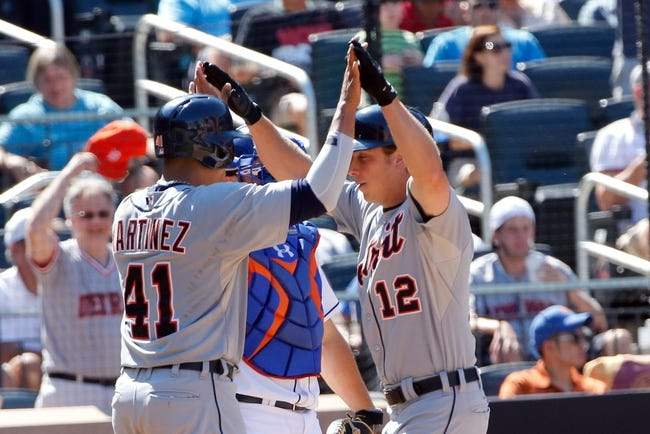 Aug 25, 2013; New York, NY, USA;  Detroit Tigers left fielder Andy Dirks (12) celebrates his home run with designated hitter Victor Martinez (41)  during the sixth inning against the New York Mets at Citi Field. Mandatory Credit: Anthony Gruppuso-USA TODAY Sports