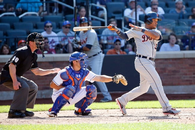 Aug 25, 2013; New York, NY, USA;  Detroit Tigers second baseman Ramon Santiago (39) singles to right allowing a runner to score during the ninth inning against the New York Mets at Citi Field. Detroit won 11-3.  Mandatory Credit: Anthony Gruppuso-USA TODAY Sports