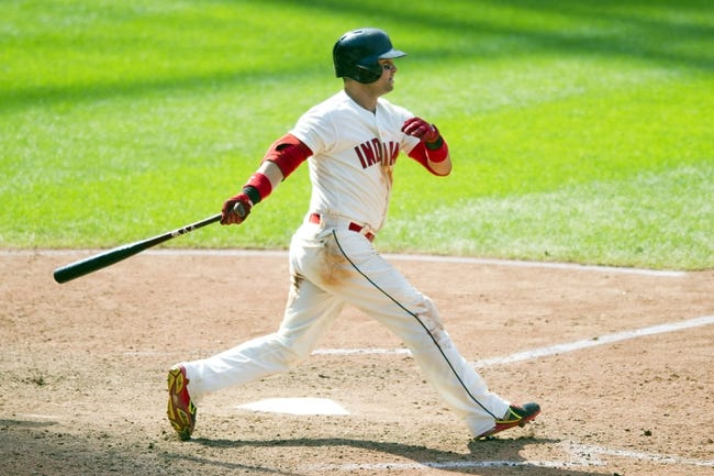 Aug 25, 2013; Cleveland, OH, USA; Cleveland Indians first baseman Nick Swisher (33) hits an RBI single in the eighth inning against the Minnesota Twins at Progressive Field. Mandatory Credit: David Richard-USA TODAY Sports