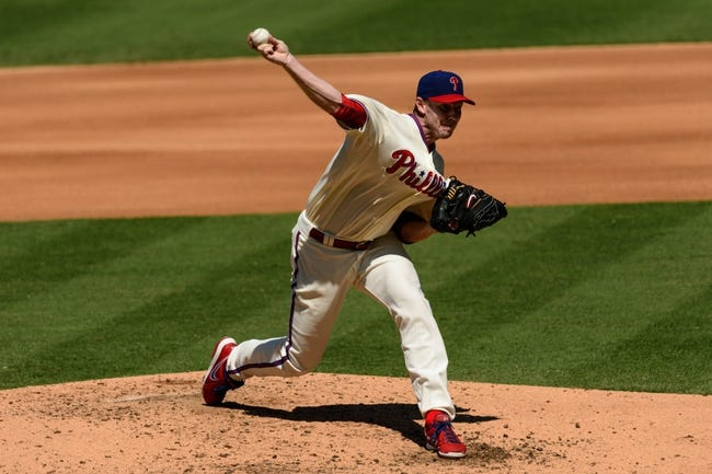 Aug 25, 2013; Philadelphia, PA, USA; Philadelphia Phillies pitcher Roy Halladay (34) delivers to the plate during the fourth inning against the Arizona Diamondbacks at Citizens Bank Park. The Phillies defeated the Diamondbacks 9-5. Mandatory Credit: Howard Smith-USA TODAY Sports