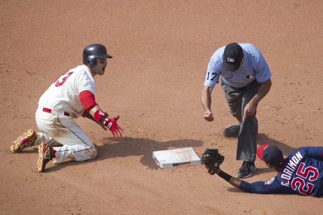Aug 25, 2013; Cleveland, OH, USA; Cleveland Indians first baseman Nick Swisher (33) reacts after being called out by second base umpire John Hirschbeck while trying to stretch a single in the seventh inning against Minnesota Twins shortstop Pedro Florimon (25) at Progressive Field. Mandatory Credit: David Richard-USA TODAY Sports