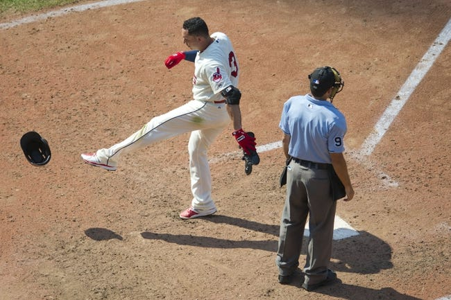 Aug 25, 2013; Cleveland, OH, USA; Cleveland Indians shortstop Asdrubal Cabrera (13) kicks his helmet beside home plate umpire James Hoye in the seventh inning against the Minnesota Twins at Progressive Field. Mandatory Credit: David Richard-USA TODAY Sports