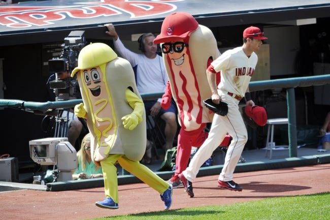 Aug 25, 2013; Cleveland, OH, USA; Cleveland Indians right fielder Drew Stubbs (11) enters the field during the hot dog derby between innings against the Minnesota Twins at Progressive Field. Mandatory Credit: David Richard-USA TODAY Sports