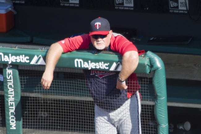 Aug 25, 2013; Cleveland, OH, USA; Minnesota Twins manager Ron Gardenhire (35) watches from the dugout in the ninth inning against the Cleveland Indians at Progressive Field. Mandatory Credit: David Richard-USA TODAY Sports