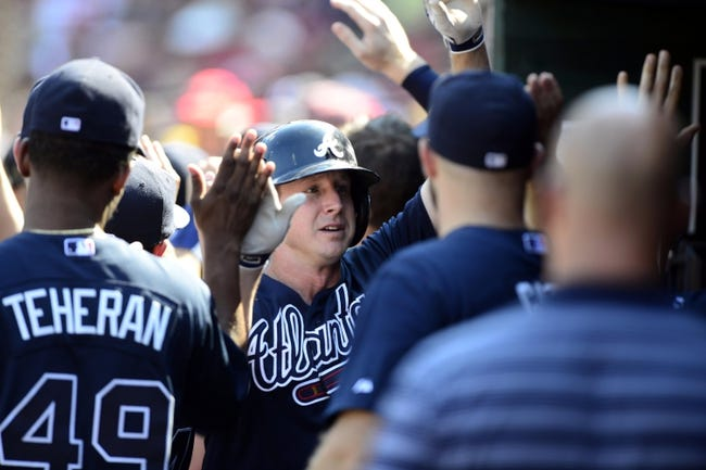 Aug 25, 2013; St. Louis, MO, USA; Atlanta Braves second baseman Elliot Johnson (30) celebrates with teammates after scoring on a sacrifice fly hit by catcher Gerald Laird (not pictured) during the eighth inning at Busch Stadium. Atlanta defeated St. Louis 5-2. Mandatory Credit: Jeff Curry-USA TODAY Sports