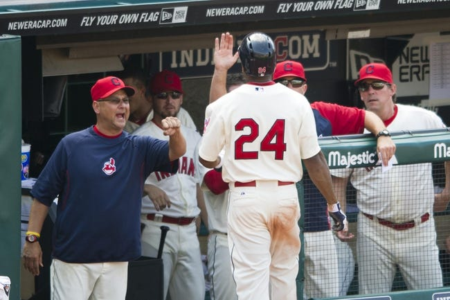 Aug 25, 2013; Cleveland, OH, USA; Cleveland Indians center fielder Michael Bourn (24) celebrates with manager Terry Francona (left) after scoring a run in the eighth inning against the Minnesota Twins at Progressive Field. Mandatory Credit: David Richard-USA TODAY Sports