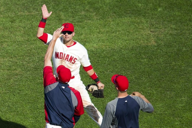 Aug 25, 2013; Cleveland, OH, USA; Cleveland Indians first baseman Nick Swisher celebrates a 3-1 win over the Minnesota Twins at Progressive Field. Mandatory Credit: David Richard-USA TODAY Sports