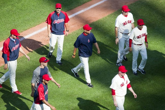 Aug 25, 2013; Cleveland, OH, USA; Cleveland Indians manager Terry Francona (center) and his players walk off the field after a 3-1 win over the Minnesota Twins at Progressive Field. Mandatory Credit: David Richard-USA TODAY Sports
