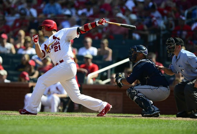 Aug 25, 2013; St. Louis, MO, USA; St. Louis Cardinals first baseman Allen Craig (21) hits a one run single off of Atlanta Braves relief pitcher Luis Avilan (not pictured) during the eighth inning at Busch Stadium. Atlanta defeated St. Louis 5-2. Mandatory Credit: Jeff Curry-USA TODAY Sports