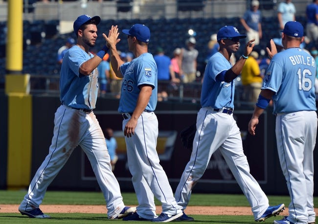 Aug 25, 2013; Kansas City, MO, USA; Kansas City Royals players Eric Hosmer (35) , George Kattaras (26) , Alcides Escobar (2) and Billy Butler celebrate after beating the Washington Nationals 6-4 at Kauffman Stadium.  Mandatory Credit: Peter G. Aiken-USA TODAY Sports