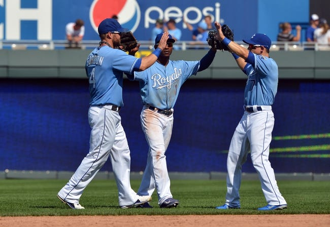 Aug 25, 2013; Kansas City, MO, USA; Kansas City Royals players Jarrod Dyson (center) , Alex Gordon (left) and David Lough (right) celebrate after beating the Washington Nationals 6-4 at Kauffman Stadium.  Mandatory Credit: Peter G. Aiken-USA TODAY Sports