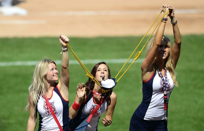 Aug 25, 2013; St. Louis, MO, USA; Team Fredbird girls launch t-shirts into the stands during the sixth inning of a game between the St. Louis Cardinals and the Atlanta Braves at Busch Stadium. Atlanta defeated St. Louis 5-2. Mandatory Credit: Jeff Curry-USA TODAY Sports