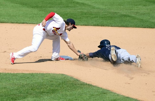 Aug 25, 2013; St. Louis, MO, USA; St. Louis Cardinals shortstop Pete Kozma (38) tags out Atlanta Braves catcher Gerald Laird (11) on a stolen base attempt during the sixth inning at Busch Stadium. Atlanta defeated St. Louis 5-2. Mandatory Credit: Jeff Curry-USA TODAY Sports