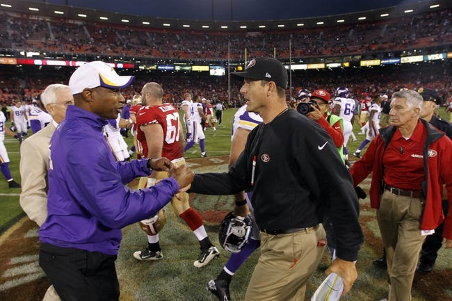 Aug 25, 2013; San Francisco, CA, USA; San Francisco 49ers head coach Jim Harbaugh shakes hands with Minnesota Vikings head coach Leslie Frazier after the 49ers defeated the Vikings 34-14 at Candlestick Park. Mandatory Credit: Cary Edmondson-USA TODAY Sports