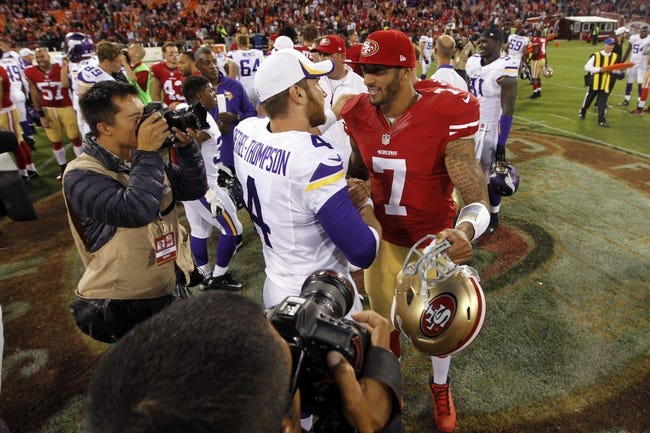 Aug 25, 2013; San Francisco, CA, USA; San Francisco 49ers quarterback Colin Kaepernick (7) talks with Minnesota Vikings quarterback McLeod Bethel-Thompson (4) after the 49ers defeated the Vikings 34-14 at Candlestick Park. Mandatory Credit: Cary Edmondson-USA TODAY Sports
