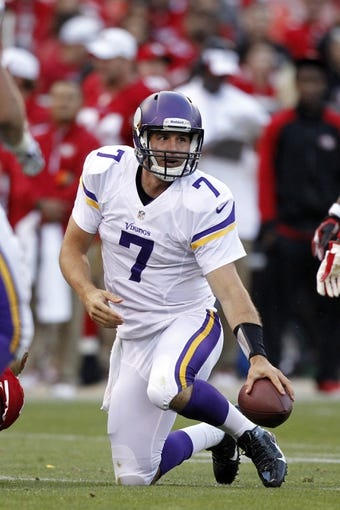 Aug 25, 2013; San Francisco, CA, USA; Minnesota Vikings quarterback Christian Ponder (7) regains his footing after running the ball against the San Francisco 49ers in the third quarter at Candlestick Park. The 49ers defeated the Vikings 34-14. Mandatory Credit: Cary Edmondson-USA TODAY Sports