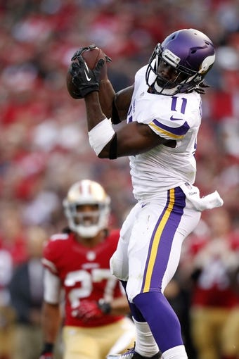 Aug 25, 2013; San Francisco, CA, USA; Minnesota Vikings wide receiver Stephen Burton (11) catches a pass against the San Francisco 49ers in the third quarter at Candlestick Park. The 49ers defeated the Vikings 34-14. Mandatory Credit: Cary Edmondson-USA TODAY Sports