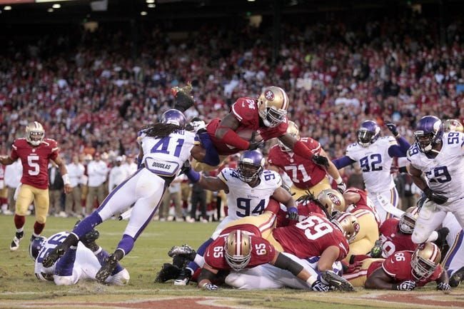 Aug 25, 2013; San Francisco, CA, USA; San Francisco 49ers running back Anthony Dixon (24) scores a touchdown against the Minnesota Vikings  in the fourth quarter at Candlestick Park. The 49ers defeated the Vikings 34-14. Mandatory Credit: Cary Edmondson-USA TODAY Sports