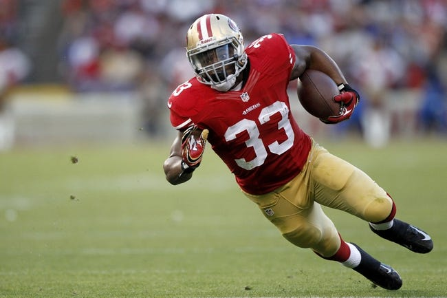 Aug 25, 2013; San Francisco, CA, USA; San Francisco 49ers running back Jewel Hampton (33) runs the ball against Minnesota Vikings in the third quarter at Candlestick Park. The 49ers defeated the Vikings 34-14. Mandatory Credit: Cary Edmondson-USA TODAY Sports