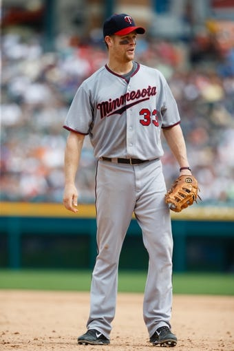 Aug 22, 2013; Detroit, MI, USA; Minnesota Twins first baseman Justin Morneau (33) in the field against the Detroit Tigers at Comerica Park. Mandatory Credit: Rick Osentoski-USA TODAY Sports