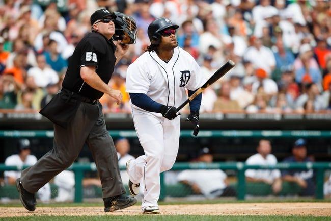 Aug 22, 2013; Detroit, MI, USA; Detroit Tigers first baseman Prince Fielder (28) and umpire Bill Welke (52) against the Minnesota Twins at Comerica Park. Mandatory Credit: Rick Osentoski-USA TODAY Sports