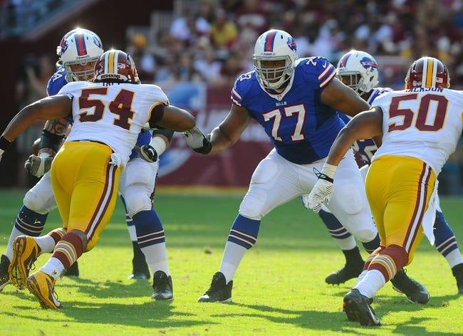Aug 24, 2013; Landover, MD, USA; Buffalo Bills offensive tackle Cordy Glenn (77) blocks Washington Redskins defensive end Darryl Tapp (54) during the first half at FedEX Field. Mandatory Credit: Brad Mills-USA TODAY Sports