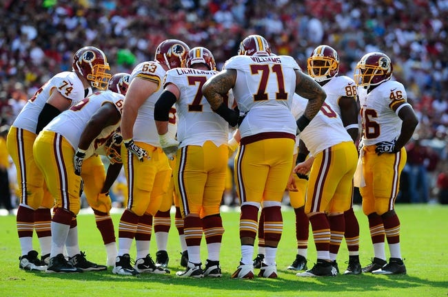 Aug 24, 2013; Landover, MD, USA; Washington Redskins offense huddles during the first half against the Buffalo Bills at FedEX Field. Mandatory Credit: Brad Mills-USA TODAY Sports