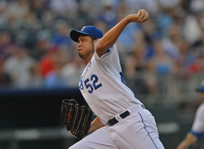 Aug 23, 2013; Kansas City, MO, USA;  Kansas City Royals pitcher Bruce Chen (52) delivers a pitch against the Washington Nationals during the first inning at Kauffman Stadium.  Mandatory Credit: Peter G. Aiken-USA TODAY Sports