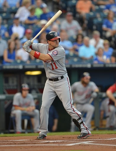 Aug 23, 2013; Kansas City, MO, USA;  Washington Nationals third basemen Ryan Zimmerman (11) at bat against the Kansas City Royals during the first inning at Kauffman Stadium.  Mandatory Credit: Peter G. Aiken-USA TODAY Sports