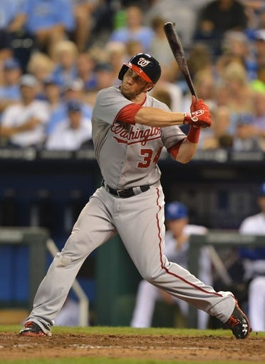 Aug 23, 2013; Kansas City, MO, USA;  Washington Nationals right fielder Bryce Harper (34) at bat against the Kansas City Royals during the fourth inning at Kauffman Stadium.  Mandatory Credit: Peter G. Aiken-USA TODAY Sports