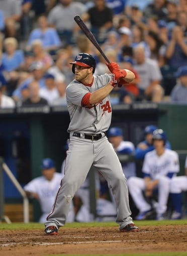 Aug 23, 2013; Kansas City, MO, USA;  Washington Nationals right fielder Bryce Harper (34) at bat against the Kansas City Royals during the third inning at Kauffman Stadium.  Mandatory Credit: Peter G. Aiken-USA TODAY Sports