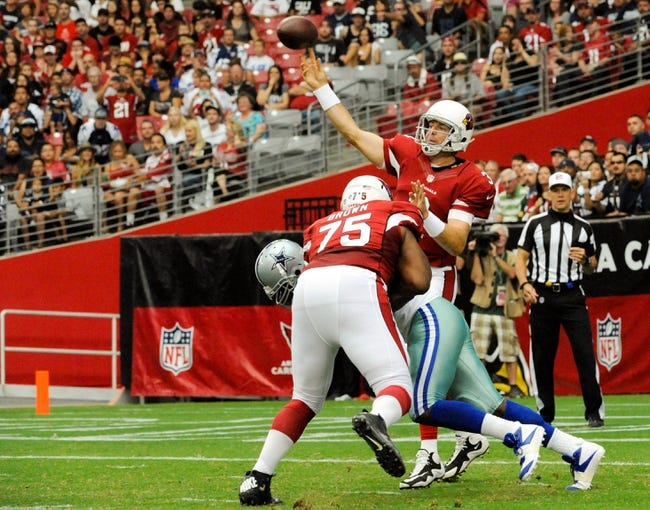Aug 17, 2013; Phoenix, AZ, USA; Arizona Cardinals quarterback Carson Palmer (3) throws a pass during the first quarter against the Dallas Cowboys at University of Phoenix Stadium. The Cardinals defeated the Cowboys 12-7. Mandatory Credit: Casey Sapio-USA TODAY Sports
