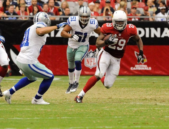 Aug 17, 2013; Phoenix, AZ, USA; Arizona Cardinals running back Alfonso Smith (29) runs the ball as he is being pursued by Dallas Cowboys cornerback Sterling Moore (21) and defensive end Kyle Wilber (51) during the second quarter at University of Phoenix Stadium. The Cardinals defeated the Cowboys 12-7. Mandatory Credit: Casey Sapio-USA TODAY Sports