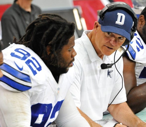 Aug 17, 2013; Phoenix, AZ, USA; Dallas Cowboys defensive line coach Rod Marinelli talks strategy with defensive end Landon Cohen (92) during fourth quarter against the Arizona Cardinals at University of Phoenix Stadium. The Cardinals defeated the Cowboys 12-7. Mandatory Credit: Casey Sapio-USA TODAY Sports