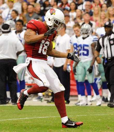 Aug 17, 2013; Phoenix, AZ, USA; Arizona Cardinals wide receiver Kerry Taylor (18) celebrates during the second quarter against the Dallas Cowboys at University of Phoenix Stadium. Mandatory Credit: Casey Sapio-USA TODAY Sports