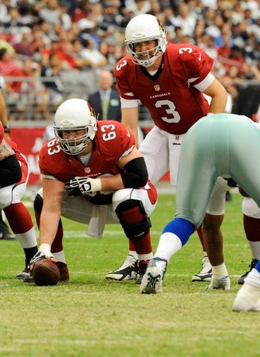 Aug 17, 2013; Phoenix, AZ, USA; Arizona Cardinals center Lyle Sendlein (63) scans the defense before snapping the ball to quarterback Carson Palmer (3) during the first quarter against the Dallas Cowboys at University of Phoenix Stadium. Mandatory Credit: Casey Sapio-USA TODAY Sports