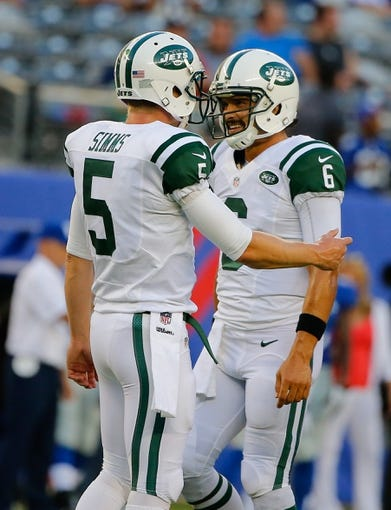 Aug 24, 2013; East Rutherford, NJ, USA; New York Jets quarterbacks Matt Simms (5) and Mark Sanchez (6) prior to the game against the New York Giants at MetLife Stadium. Mandatory Credit: Jim O'Connor-USA TODAY Sports