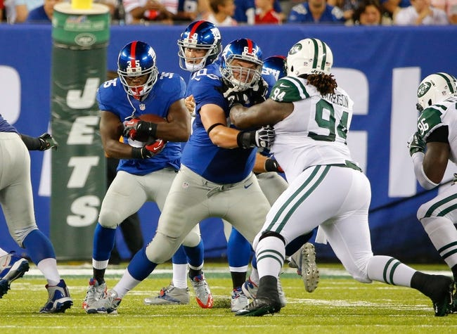 Aug 24, 2013; East Rutherford, NJ, USA; New York Giants center Jim Cordle (63) opens hole for running back Andre Brown (35) blocking New York Jets defensive tackle Damon Harrison (94) during the first half at MetLife Stadium. Mandatory Credit: Jim O'Connor-USA TODAY Sports