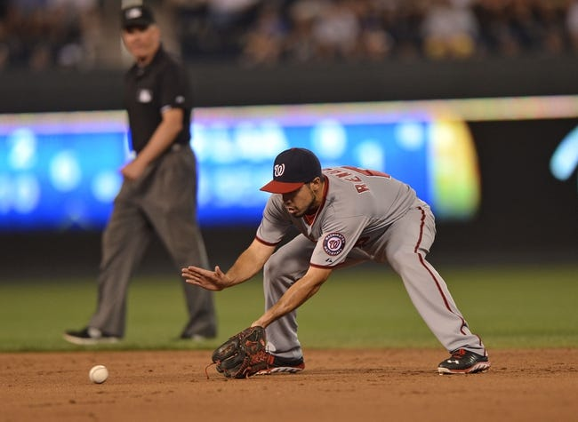 Aug 23, 2013; Kansas City, MO, USA;  Washington Nationals second basemen Anthony Rendon (6) fields a ground ball against the Kansas City Royals during the fifth inning at Kauffman Stadium.  Mandatory Credit: Peter G. Aiken-USA TODAY Sports