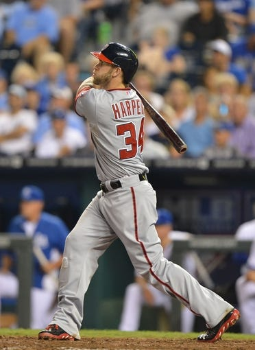 Aug 23, 2013; Kansas City, MO, USA;  Washington Nationals right fielder Bryce Harper (34) hits a three-run double against the Kansas City Royals during the fourth inning at Kauffman Stadium.  Mandatory Credit: Peter G. Aiken-USA TODAY Sports
