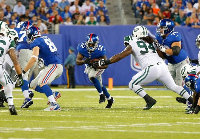 Aug 24, 2013; East Rutherford, NJ, USA; New York Giants running back David Wilson (22) finds hole as New York Jets defensive tackle Damon Harrison (94) tries to stop him during the first half at MetLife Stadium. Mandatory Credit: Jim O'Connor-USA TODAY Sports