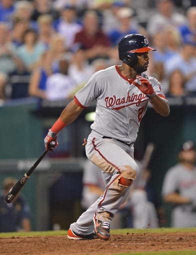 Aug 23, 2013; Kansas City, MO, USA;  Washington Nationals center fielder Denard Span (2) at bat against the Kansas City Royals during the seventh inning at Kauffman Stadium.  Mandatory Credit: Peter G. Aiken-USA TODAY Sports