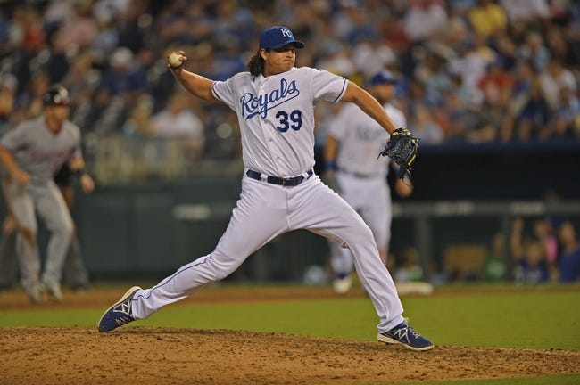Aug 23, 2013; Kansas City, MO, USA;  Kansas City Royals pitcher Luis Mendoza (39) delivers a pitch against the Washington Nationals during the eighth inning at Kauffman Stadium.  Mandatory Credit: Peter G. Aiken-USA TODAY Sports