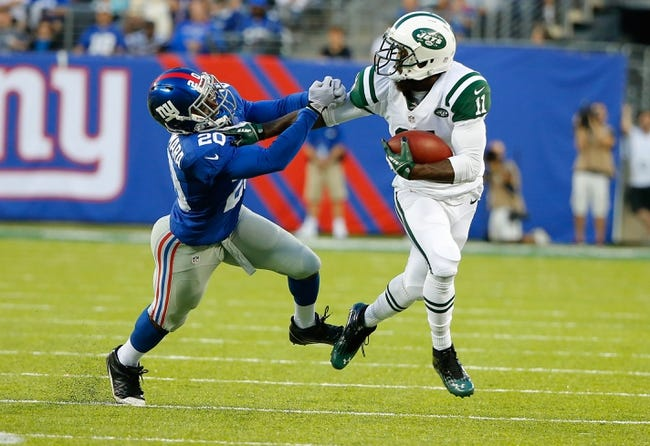 Aug 24, 2013; East Rutherford, NJ, USA; New York Jets wide receiver Jeremy Kerley (11) pushes off New York Giants cornerback Prince Amukamara (20) after reception during the first half at MetLife Stadium. Mandatory Credit: Jim O'Connor-USA TODAY Sports
