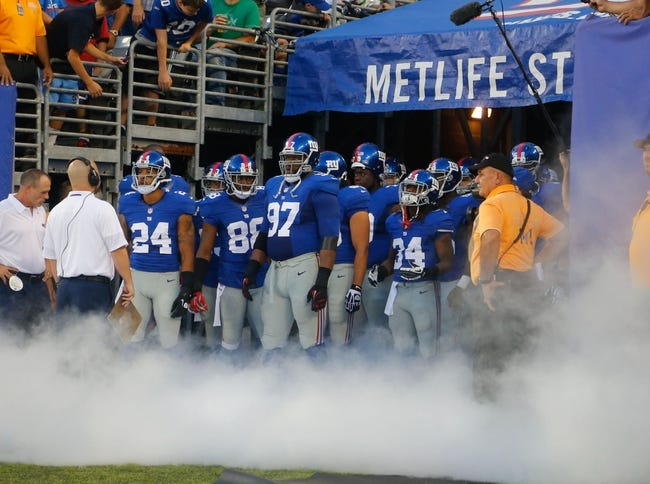 Aug 24, 2013; East Rutherford, NJ, USA; New York Giants get ready to take the field against the New York Jets at MetLife Stadium. Mandatory Credit: Jim O'Connor-USA TODAY Sports