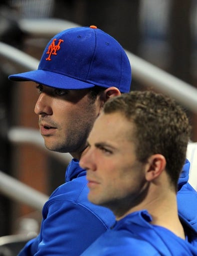 Aug 26, 2013; New York, NY, USA; New York Mets injured starting pitcher Matt Harvey (33) and injured third baseman David Wright (5) in the dugout during the second inning of a game against the Philadelphia Phillies at Citi Field. Mandatory Credit: Brad Penner-USA TODAY Sports